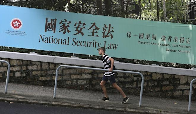 A signboard near the Hong Kong Zoological and Botanical Gardens in Central touts the new national security law Beijing is tailor-making for the city. Photo: Jonathan Wong