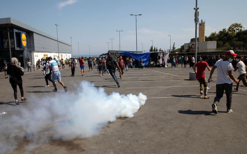 Police fire teargas as migrants demand to leave Greek island after fire