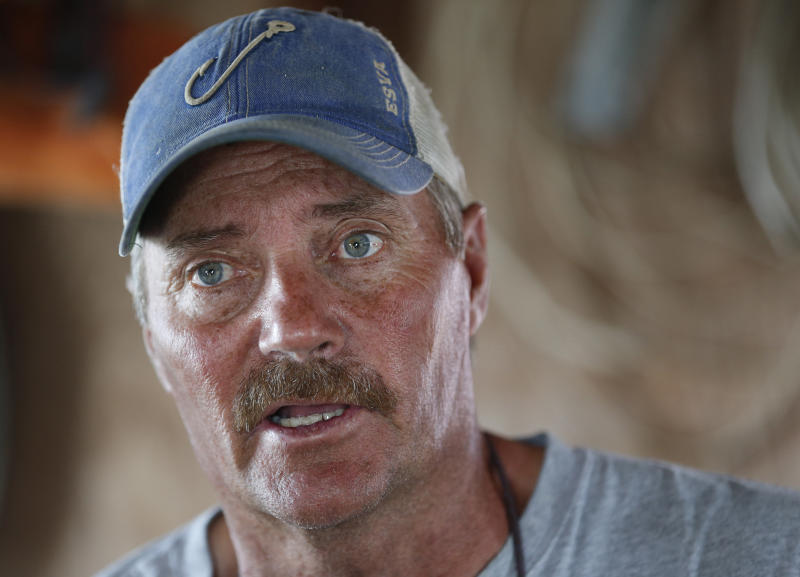 """FIL - In this Wednesday May 17, 2017 file photo, Tangier Island mayor, James """"Ooker"""" Eskridge, talks during an interview in Tangier, Va. The fishing community in the middle of the Chesapeake Bay has reported zero cases of the coronavirus. But the virus would be devastating if it were to reach the island, which has a large elderly population and no full-time doctor. (AP Photo/Steve Helber)"""