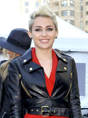 Miley Cyrus Adds a Heart Tattoo Amid Rumors of a Breakup