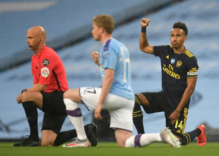 Manchester City and Arsenal players took a knee before kick-off on the Premier League's restart on Wednesday