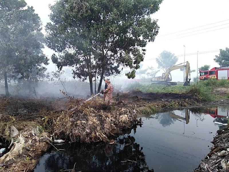 Firemen are seen dousing fire in a peat swamp at Pulau Bruit in Mukah, August 13, 2019. — Picture courtesy of the Sarawak Fire and Rescue Department