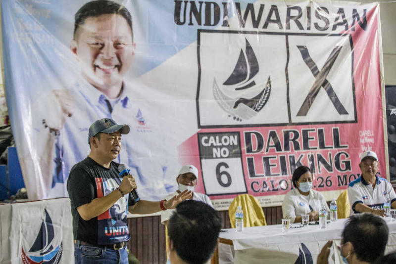 Warisan deputy president and Moyog candidate Darell Leiking speaks while campaigning in Moyog, Sabah September 20, 2020. — Picture by Firdaus Latif