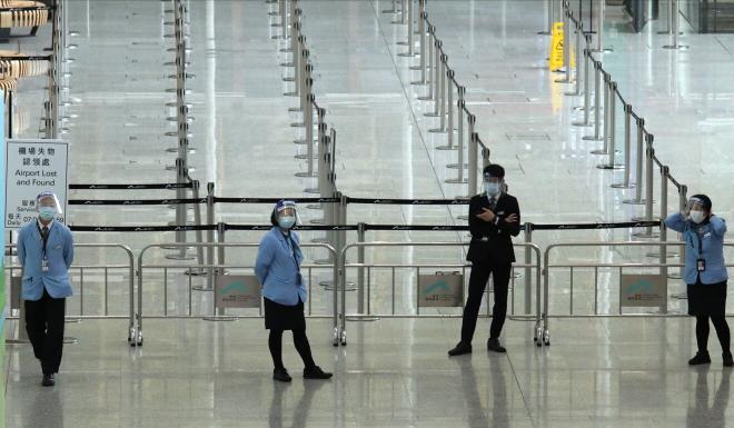 Staff at Hong Kong International Airport. Photo: Nora Tam
