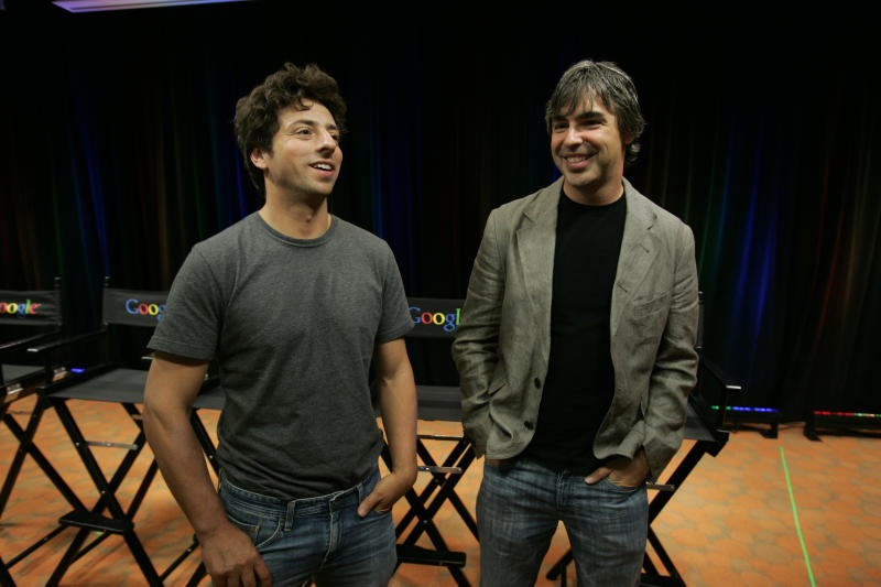 "FILE - In this Sept. 2, 2008, file photo Google co-founders Sergey Brin, left, and Larry Page talk about the new Google Browser, ""Chrome,"" during a news conference at Google Inc. headquarters in Mountain View, Calif. Page and Brin are stepping down from their roles within the parent company, Alphabet. Page, who had been serving as CEO of Alphabet, and Brin, who had been president of Alphabet, will remain on the board of the company. (AP Photo/Paul Sakuma, File)"