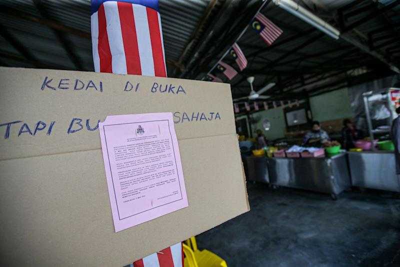 A DBKL notice ordering the closure of at an eatery is seen in Kampung Baru, Kuala Lumpur March 19, 2020. — Picture by Hari Anggara