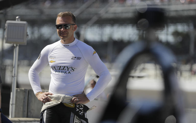 FILE - In this May 25, 2018, file photo, Ed Carpenter waits for the start the final practice session for the IndyCar Indianapolis 500 auto race at Indianapolis Motor Speedway in Indianapolis. Things are starting to feel a little more normal for Ed Carpenter with IndyCar finally about to start its season, though his body clock is still out of sorts. The lone owner-driver in the series surely isn't alone feeling that way.  (AP Photo/Darron Cummings, File)