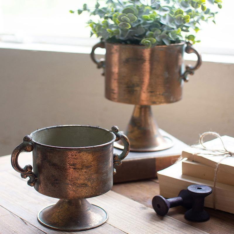 """<p><strong>Jungalow</strong></p><p>jungalow.com</p><p><strong>$99.00</strong></p><p><a href=""""https://www.jungalow.com/collections/planters/products/copper-planters"""" target=""""_blank"""">Shop It</a></p><p>The slightly aged look of these copper planters works flawlessly with colorful floral bouquets or the pastel pink and cream streaks of a Magenta Triostar plant. </p>"""