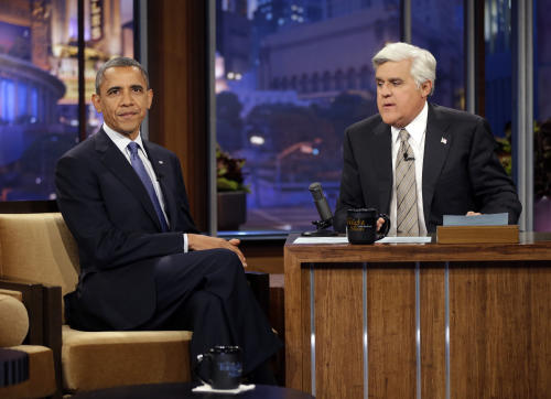 President Barack Obama is seen with Jay Leno, right, during a commercial break during the taping of his appearance on NBC's The Tonight Show with Jay Leno, Wednesday, Oct. 24, 2012, in Burbank, Calif. (AP Photo/Pablo Martinez Monsivais)