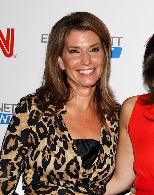 """FILE - This Sept. 27, 2011 file photo originally released by Starpix shows CNN anchor Carol Costello, at a party launching her colleague, Erin Burnett's show """"Erin Burnett Outfront,"""" in New York. Atlanta police are investigating after a CNN anchor reported that her iPhone was snatched from her hand as she strolled down a street on Thursday, May 2, 2013. Police tell WSB-TV that Carol Costello was talking on the phone while walking when two teenagers ran up from behind and grabbed the phone. Costello said in a post on her Facebook page that she struggled with one suspect as she tried to keep her phone, but he pulled out a chunk of her hair and she let go. (AP Photo/Starpix, Amanda Schwab, file)"""