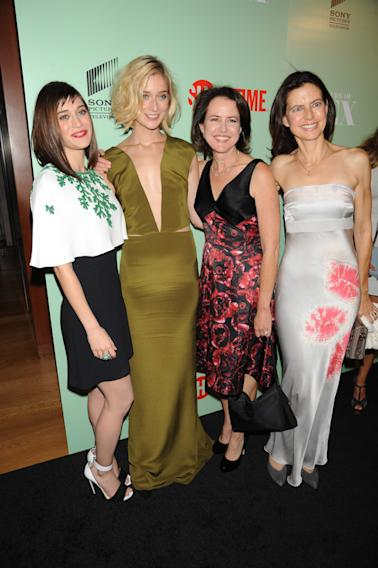 Lizzy Caplan, Caitlin Fitzgerald, Michelle Ashford and Sarah Timberman seen at the premiere screening of MASTERS OF SEX, hosted by SHOWTiME and SONY PICTURES TELEVISION, on Thursday, September 26, 2013 at The Morgan Library and Museum in New York City. (Photo by Scott Gries/Invision for SHOWTIME/AP Images)