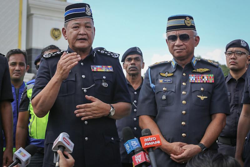 IGP Tan Sri Abdul Hamid Bador and Chief of Defence Force Gen Tan Sri Affendi Buang speak to reporters outside Istana Negara in Kuala Lumpur February 28, 2020. — Picture by Yusof Mat Isa