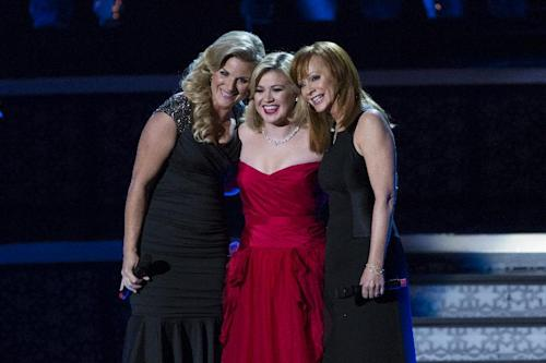 "This image released by NBC shows, from left, Trisha Yearwood, Kelly Clarkson, and Reba McEntire during the taping of ""Kelly Clarkson's Cautionary Christmas Music Tale,"" in Las vegas, Nev. NBC says Robin Williams, Whoopi Goldberg and William Shatner are among those joining Kelly Clarkson's holiday special. The special, also is set to include country stars Blake Shelton, Reba McEntire and Trisha Yearwood, will air at 10 p.m. EST Dec. 11 on NBC. (AP Photo/NBC, Justin Lubin)"