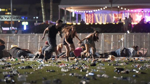 PHOTO: People run from the Route 91 Harvest country music festival, Oct. 1, 2017, in Las Vegas. (David Becker/Getty Images)