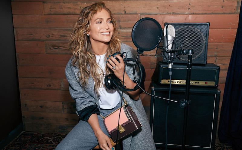 Jennifer Lopez wears the new special-edition handbag she designed in collaboration with Coach. Image via Coach.
