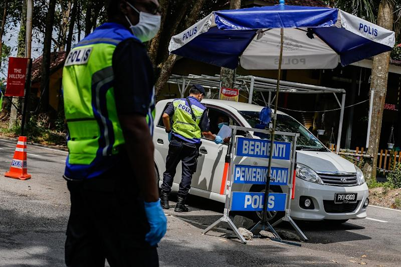 Policemen and Army personnel join forces to man the roadblocks at the entrance and exits to Balik Pulau at Jalan Tun Sardon in Penang April 10, 2020. — Picture by Sayuti Zainudin