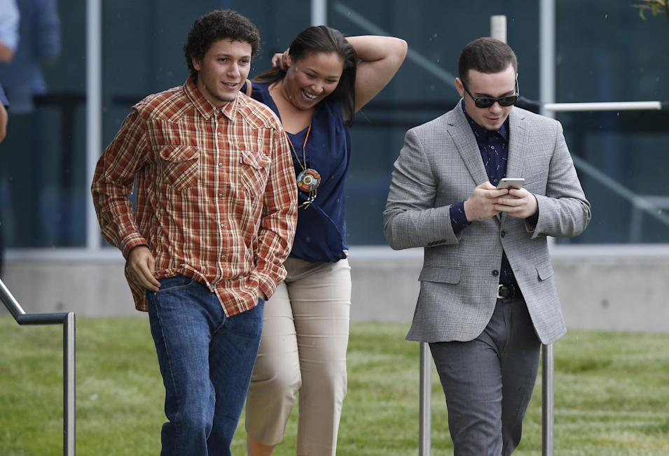 Yousef Gharbi, left, who was shot in the head during the Aurora, Colo., theatre shooting, emerges from Arapahoe County Courthouse after jurors convicted theatre shooter James Holmes in the July 2012 shooting spree as the trial concluded Thursday, July 16, 2015, in Centennial, Colo. The 27-year-old Holmes, who had been working toward his Ph.D. in neuroscience, could get the death penalty for the massacre that left 12 people dead and dozens of others wounded early Friday, July 20, 2012. (AP Photo/David Zalubowski)