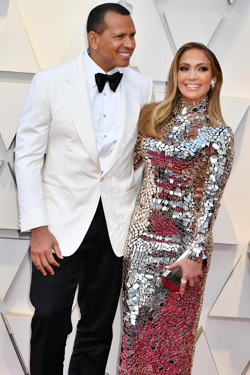 Alex Rodriguez and Jennifer Lopez in silver gown on the red carpet