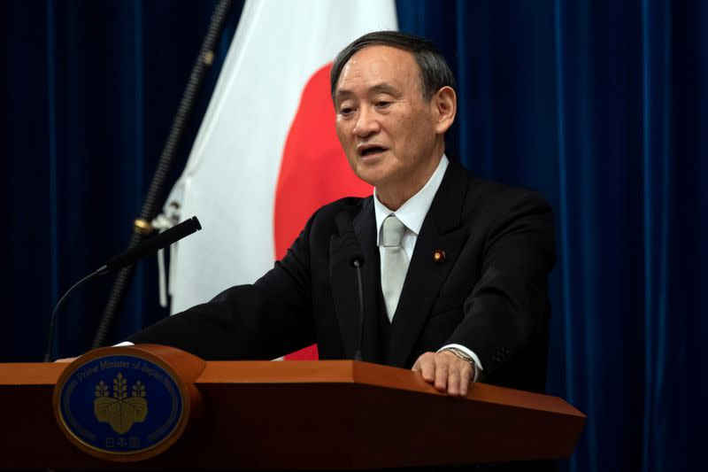 Japan's PM says to gradually allow foreign long-term visa holders to enter from October