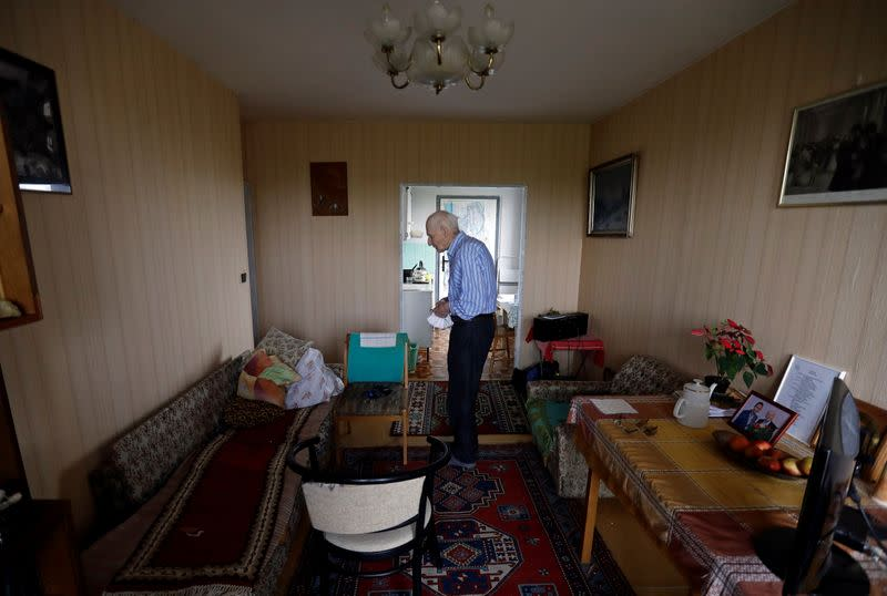 Petr Brandejsky, a 90-year-old Holocaust survivor, stands at his apartment in Prague