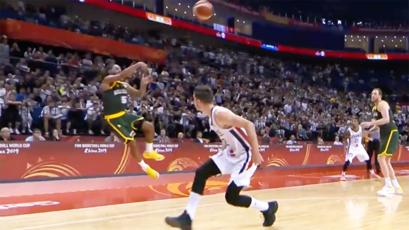 Patty Mills, pictured making a steal in the dying seconds, was once again the hero for Australia.