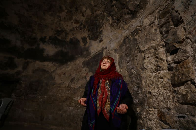 A worshipper prays inside the Syrian Orthodox section of the Church of the Holy Sepulchre, revered as the site of Jesus's crucifixion and burial, in Jerusalem's Old City