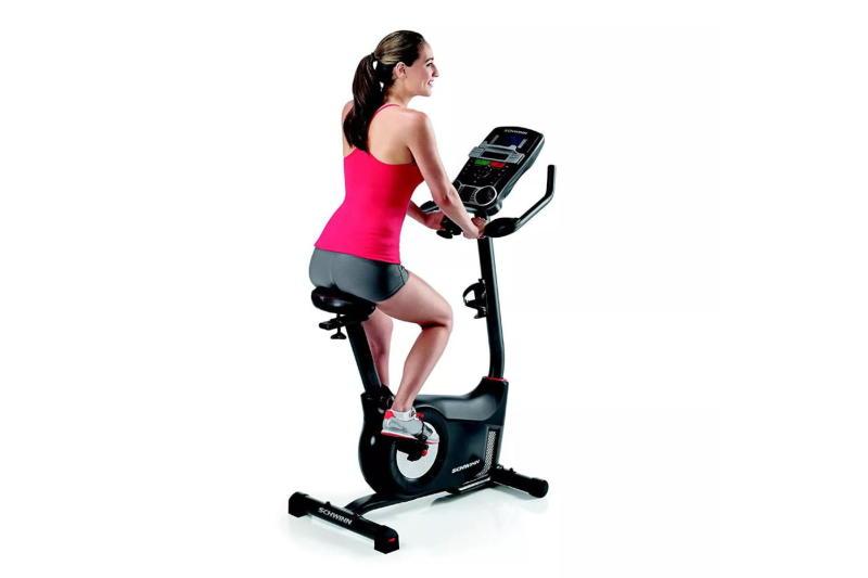 woman riding Schwinn Fitness 170