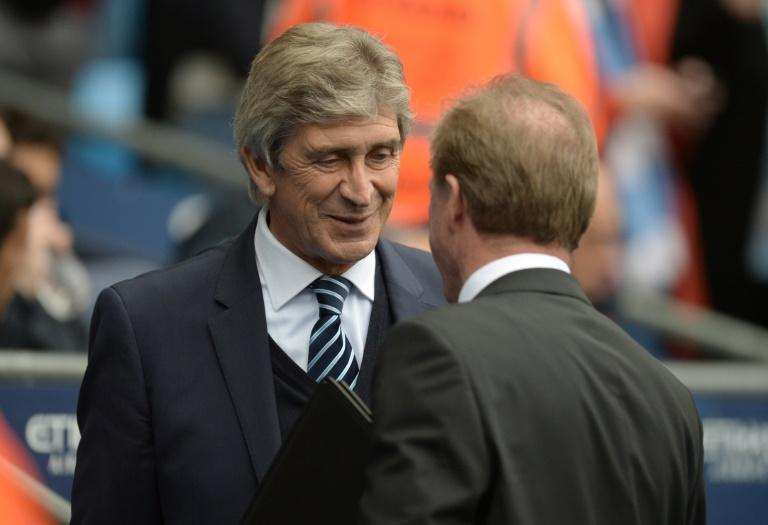 Manchester City's manager Manuel Pellegrini (L) greets Newcastle United's counterpart Steve McClaren ahead of their English Premier League match, at the Etihad Stadium in Manchester, on October 3, 2015