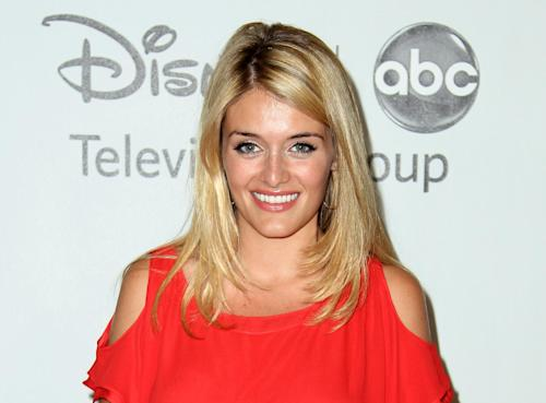 """FILE - This July 27, 2012 file photo shows Daphne Oz at the Disney ABC Television Group 2012 Summer Press Tour All-Star Cocktail Reception in Beverly Hills, Calif. Oz, a host of ABC's daytime program """"The Chew"""" and daughter of talk show host Dr. Mehmet Oz, announced her pregnancy Thursday, Sept. 5, 2013, during a taping of the show's season premiere, which will air Monday. It will be the first grandchild for Dr. Oz and his wife, Lisa. (Photo by Matt Sayles/Invision/AP, File)"""