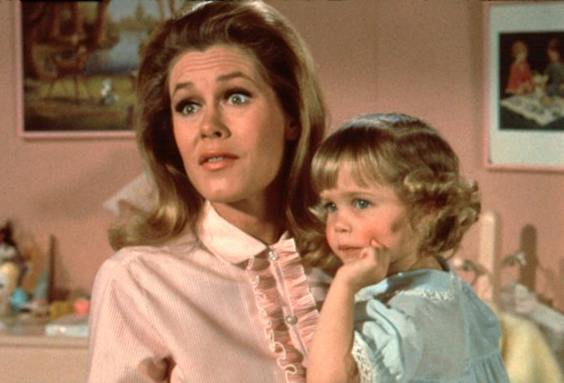 elizabeth montgomery holding small child from bewitched