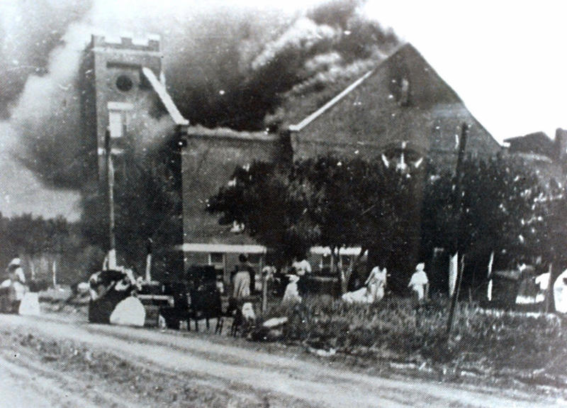 FILE - In this 1921 file image provided by the Greenwood Cultural Center via Tulsa World, Mt. Zion Baptist Church burns after being torched by white mobs during the 1921 Tulsa massacre. Black community and political leaders called on President Donald Trump to at least change the Juneteenth date for a rally kicking off his return to public campaigning, saying Thursday, June 11, 2020. From Sen. Kamala Harris of California to Tulsa civic officials, black leaders said it was offensive for Trump to pick that date — June 19 — and that place — Tulsa, an Oklahoma city that in 1921 was the site of a fiery and orchestrated white-on-black killing spree. (Greenwood Cultural Center via Tulsa World via AP)