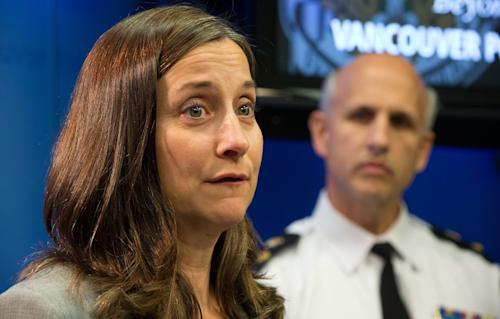 """British Columbia Chief Coroner Lisa Lapointe speaks about the death of Canadian actor Cory Monteith as Vancouver Police Acting Chief Doug LePard, right, listens during a news conference in Vancouver, British Columbia, late Saturday,July 13, 2013. Vancouver police say Canadian born actor Montieth, star of the hit show """"Glee"""" has been found dead in city hotel. (AP Photo/The Canadian Press, Darryl Dyck)"""
