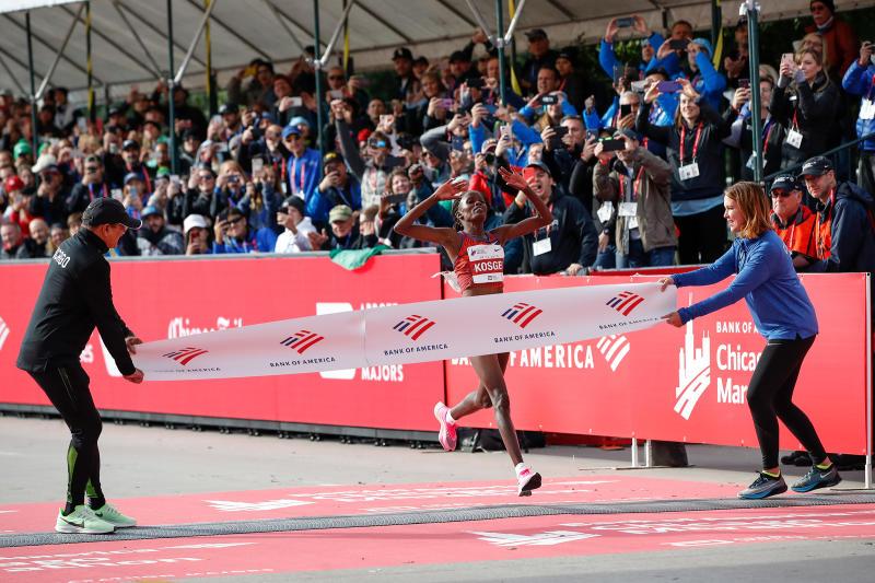 Kenya's Brigid Kosgei crosses the finish line as she wins the women's 2019 Bank of America Chicago Marathon on Oct. 13, 2019. | Kamil Krzaczynski—AFP/Getty Images