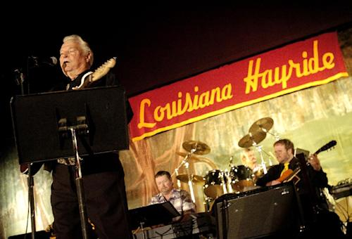 "In a Feb. 24, 2008 photo Country musician Claude King performs during a Louisiana Hayride show at the Municipal Auditorium in Shreveport, La. Country singer-songwriter Claude King, an original member of the Louisiana Hayride who was best known for the 1962 hit ""Wolverton Mountain,"" has died. He was 90. (AP Photo/The Shreveport Times, Val Horvath) MAGS OUT; MANDATORY CREDIT SHREVEPORTTIMES.COM; NO SALES"