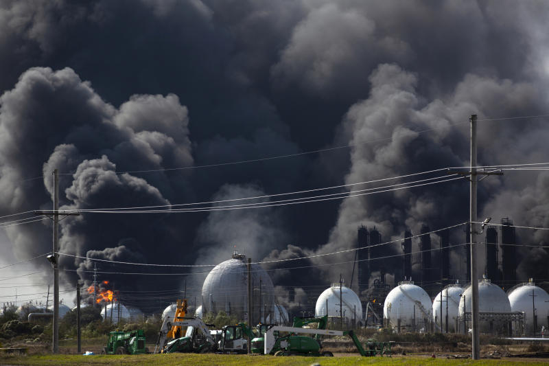 Smoke from an explosion at the TPC Group plant is seen Wednesday, Nov. 27, 2019, in Port Neches, Texas. Two massive explosions 13 hours apart tore through the chemical plant Wednesday, and one left several workers injured. (Marie D. De Jesús/Houston Chronicle via AP)