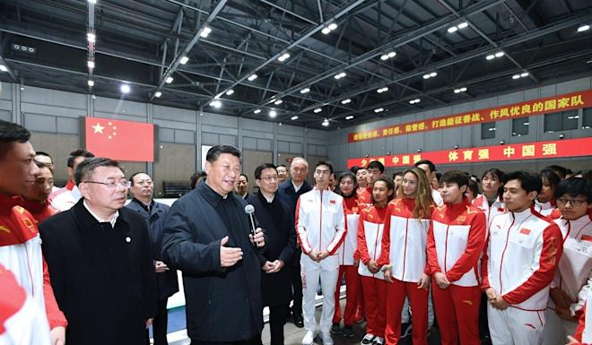 President Xi Jinping meets members of China's winter sports team at their training centre in Beijing. Photo: Xinhua