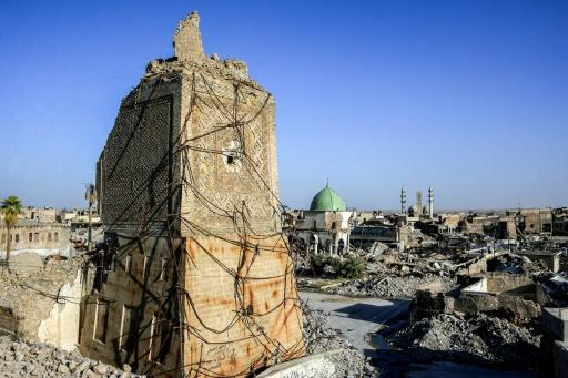 """The base of Mosul's famous destroyed """"Al-Hadba"""" leaning minaret is pictured on July 9, 2018, a year after Iraqi forces ousted the Islamic State group from Iraq's second city"""