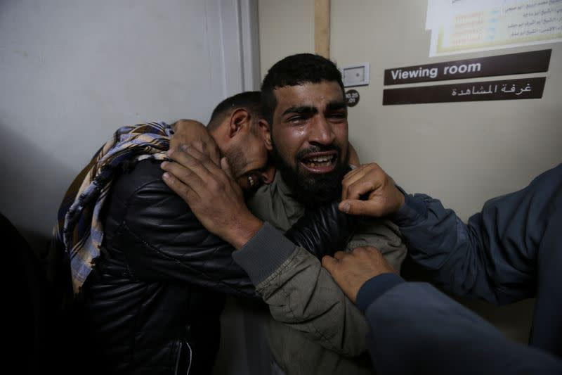 Relatives of a Palestinian teenager who was killed near the border fence, mourn at the hospital in the southern Gaza Strip
