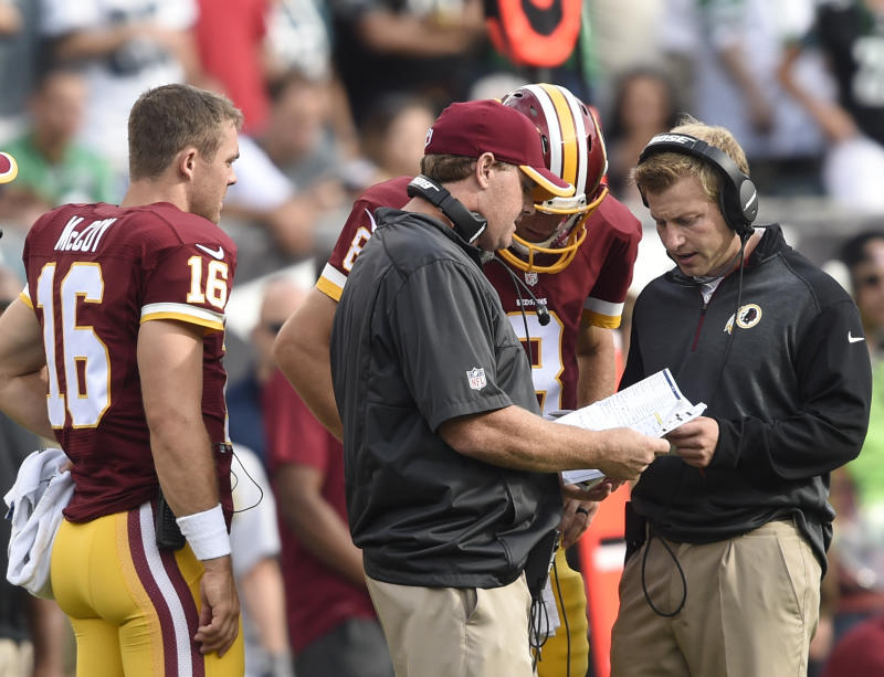 PHILADELPHIA - SEPTEMBER 21: Washington Redskins head coach Jay Gruden, center, and Washington Redskins offensive coordinator Sean McVay, right, talks with Washington Redskins quarterback Kirk Cousins (8) in the fourth quarter during the game between the Washington Redskins and the Philadelphia Eagles at Lincoln Financial Field on Sunday, September 21, 2014. The Philadelphia Eagles defeated the Washington Redskins 37-34. Photo by Toni L. Sandys/The Washington Post via Getty Images)