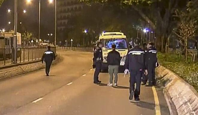 Police arrive on the scene following the collision, which was recorded at 11.47pm Monday. Photo: NOW TV