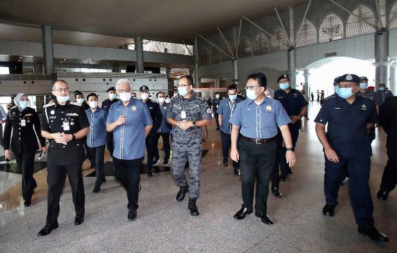 Home Minister Datuk Seri Hamzah Zainudin (3rd left) during his visit to the Bangunan Sultan Iskandar building that houses the customs, immigration and quarantine (CIQ) facility in Johor Baru April 7, 2020. — Picture by Ben Tan