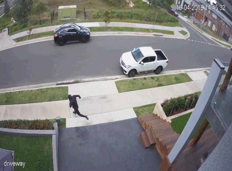 The gunman runs away from the scene. Source: NSW Police