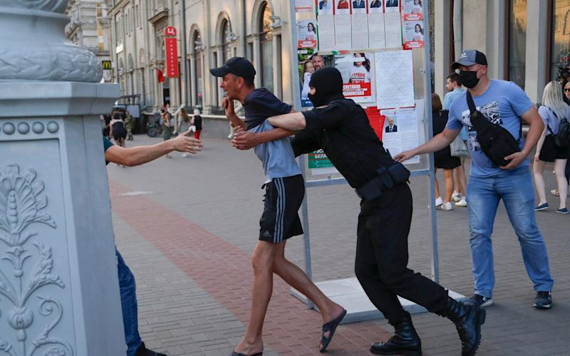 Belarusian police officers detain a man in Minsk, Belarus, Saturday, Aug. 8, 2020 - AP