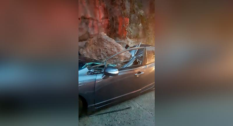 The boulder crushed the car (pictured) in Guatemala