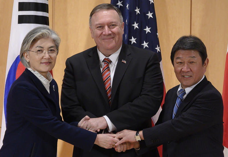 U.S. Secretary of State Mike Pompeo, center, shakes hands with Japan's Foreign Minister Toshimitsu Motegi, right, and South Korea's Foreign Minister Kang Kyung-wha during a trilateral meeting during the 56th Munich Security Conference (MSC) in Munich, southern Germany, Saturday, Feb. 15, 2020.  (Andrew Caballero-Reynolds/Pool Photo via AP)
