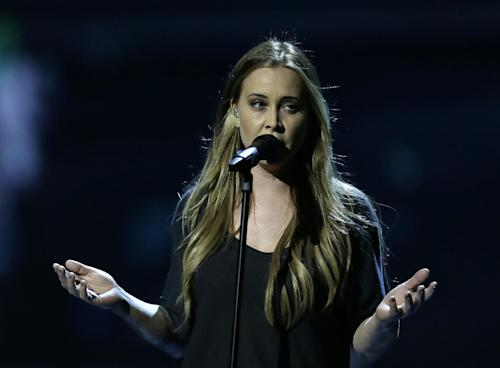 "Anouk of the Netherlands performs her song ""Birds"" during a rehearsal for the final of the Eurovision Song Contest at the Malmo Arena in Malmo, Sweden, Friday, May 17, 2013. The contest is run by European television broadcasters with the event being held in Sweden as they won the competition in 2012, the final will be held in Malmo on May 18. (AP Photo/Alastair Grant)"