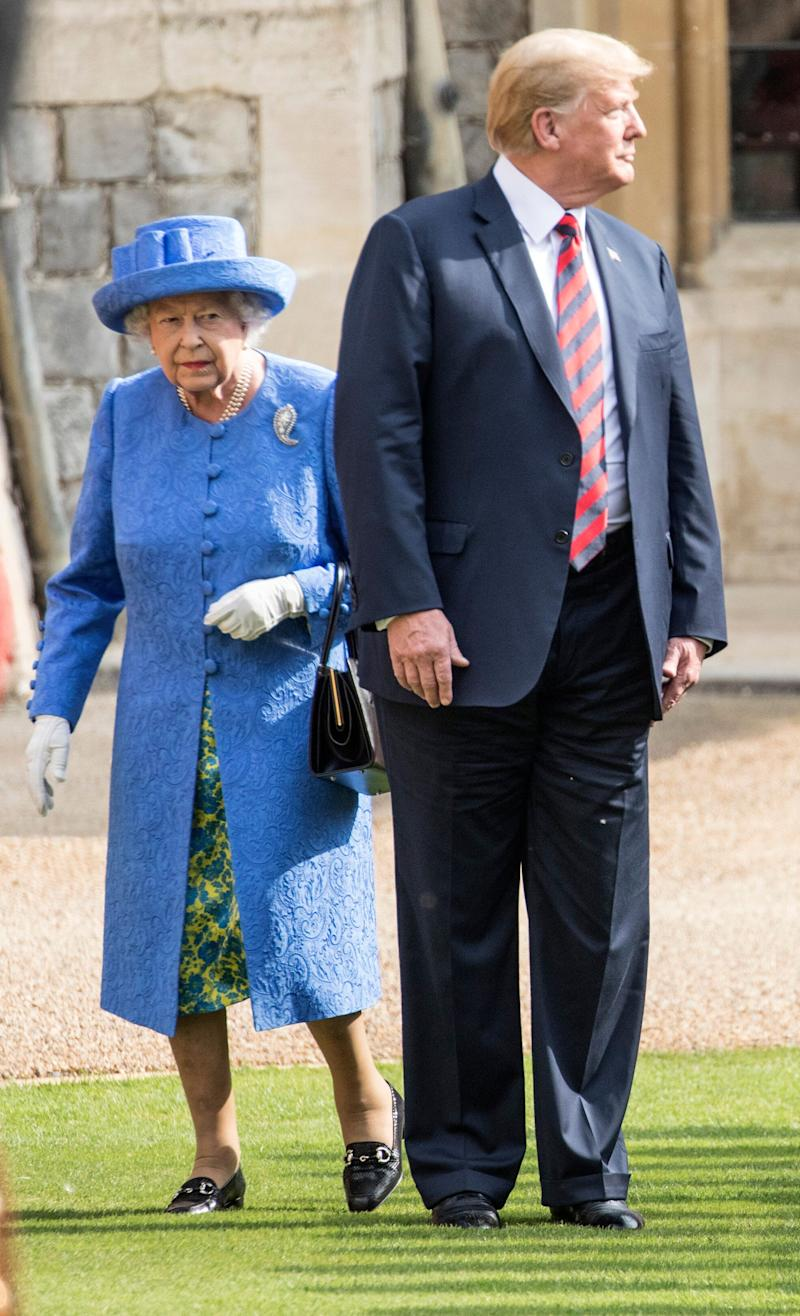 President Donald Trump and Britain's Queen Elizabeth II inspect a Guard of Honour, formed of the Coldstream Guards at Windsor Castle on July 13, 2018 in Windsor, England. Her Majesty welcomed the President and Mrs Trump at the dais in the Quadrangle of the Castle. A Guard of Honour, formed of the Coldstream Guards, gave a Royal Salute and the US National Anthem was played. The Queen and the President inspected the Guard of Honour before watching the military march past. The President and First Lady then joined Her Majesty for tea at the Castle. (Photo by Richard Pohle - WPA Pool/Getty Images)