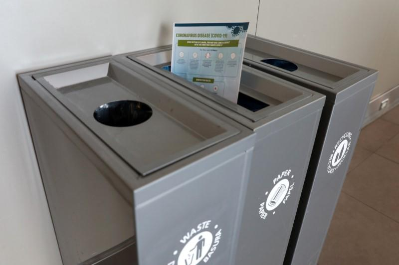 FILE PHOTO: A health pamphlet about novel coronavirus disease (COVID-19) is seen in a recycling bin at Billy Bishop Airport in Toronto