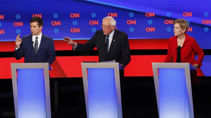 South Bend Mayor Pete Buttigieg, Sen. Bernie Sanders, I-Vt., and Sen. Elizabeth Warren, D-Mass., participate in the first of two Democratic presidential primary debates hosted by CNN Tuesday, July 30, 2019, in the Fox Theatre in Detroit. (AP Photo/Paul Sancya)