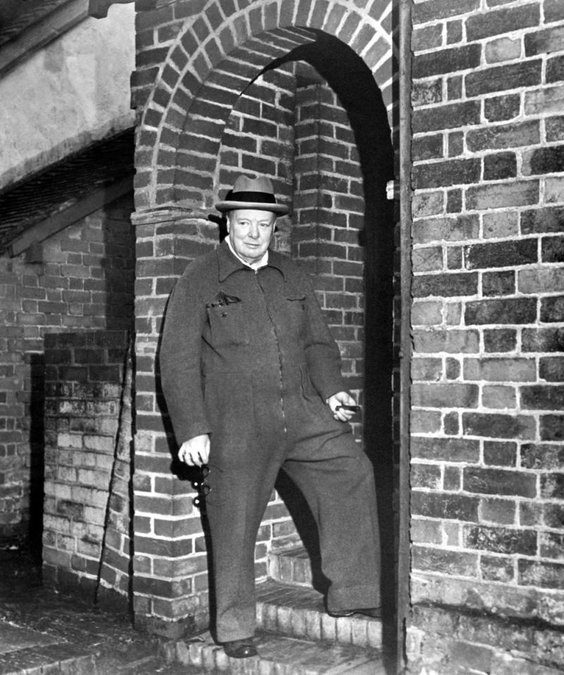 HRAC98 Winston Churchill relaxing in a siren suit smoking a cigar